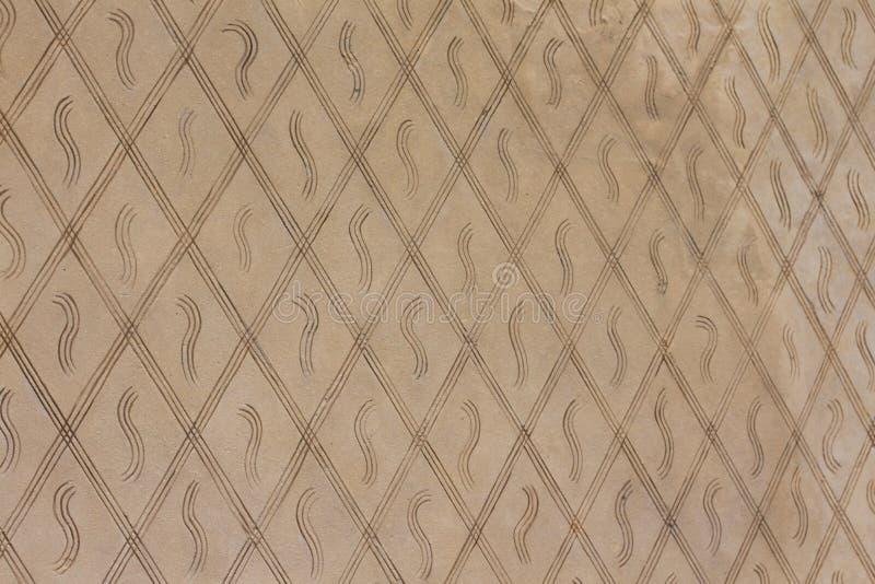Een achtergrond die uit geometrische vormen bestaan Een muur van bruine ruiten royalty-vrije stock fotografie
