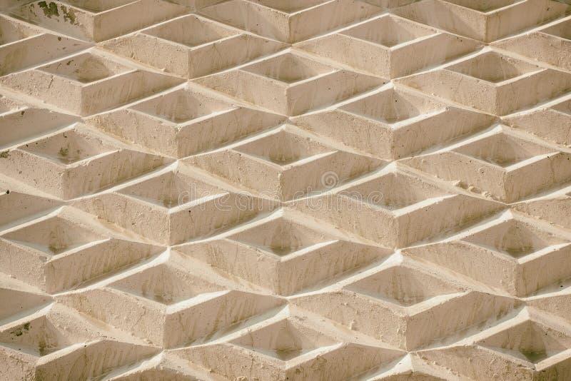 Een achtergrond die uit geometrische vormen bestaan Een muur van ruiten stock fotografie
