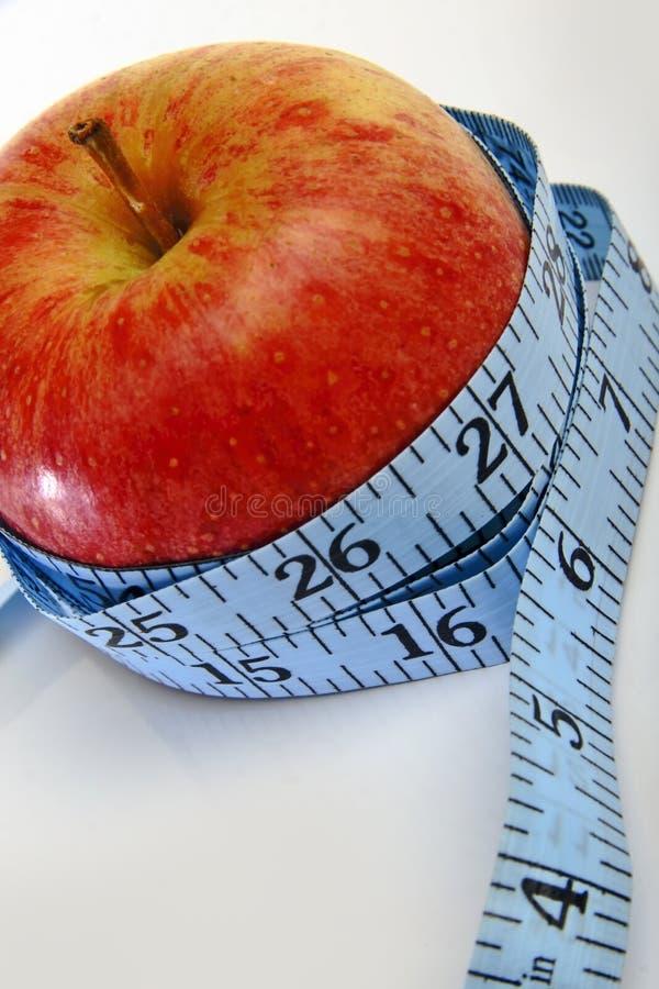 Een appel, die weightloss bevordert royalty-vrije stock afbeelding