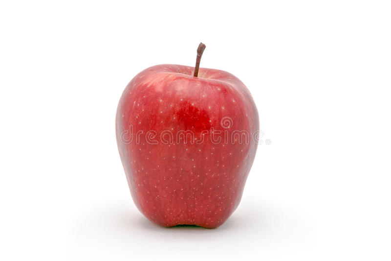 Een appel in nadruk die op een witte achtergrond wordt geïsoleerd stock foto's