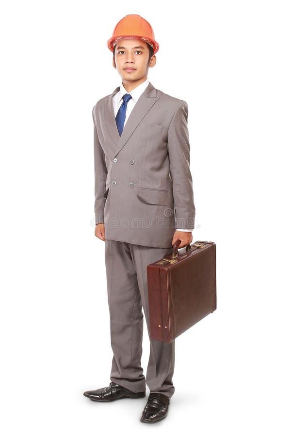 Een architecten dragende koffers stock foto
