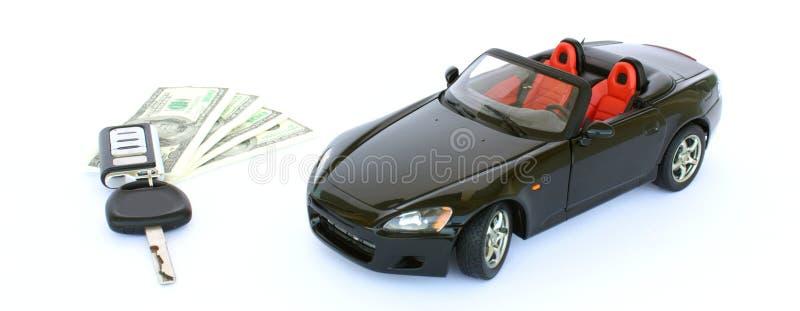 Een auto, een sleutel en een geld royalty-vrije stock foto's