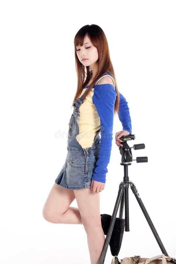 Een Aziatisch meisje met de driepoot royalty-vrije stock foto's