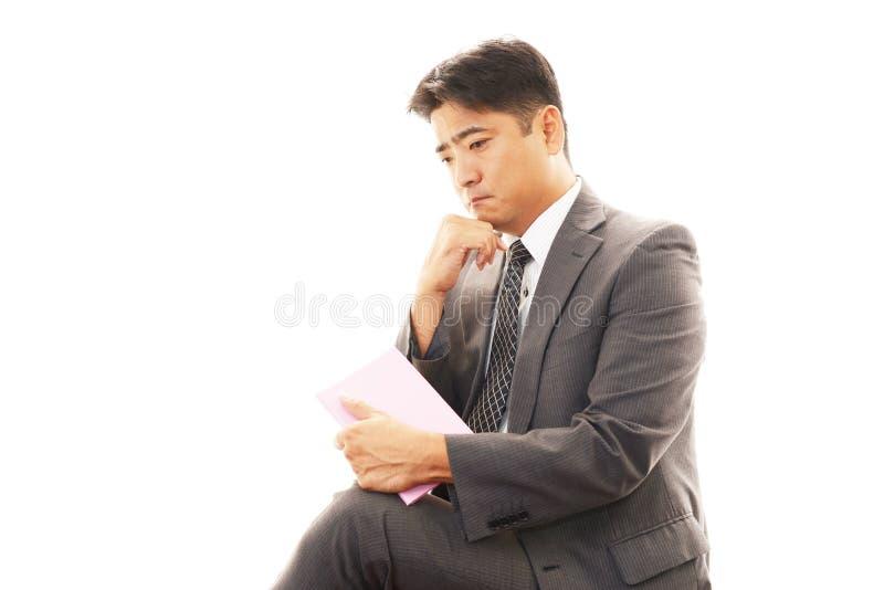 Een Aziatische zakenman stock foto's