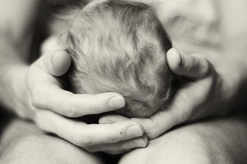 Een baby en zijn vader stock afbeelding
