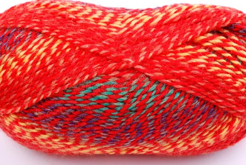 Een bal van rode wol op wit royalty-vrije stock afbeeldingen