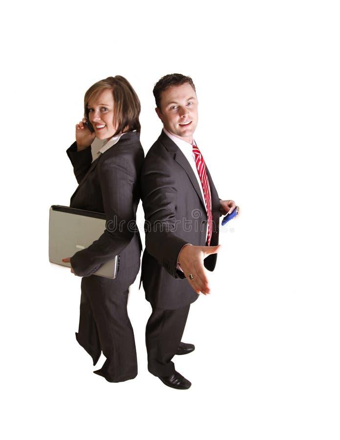 Een bedrijfsman en een vrouw rijtjes in een studio royalty-vrije stock foto