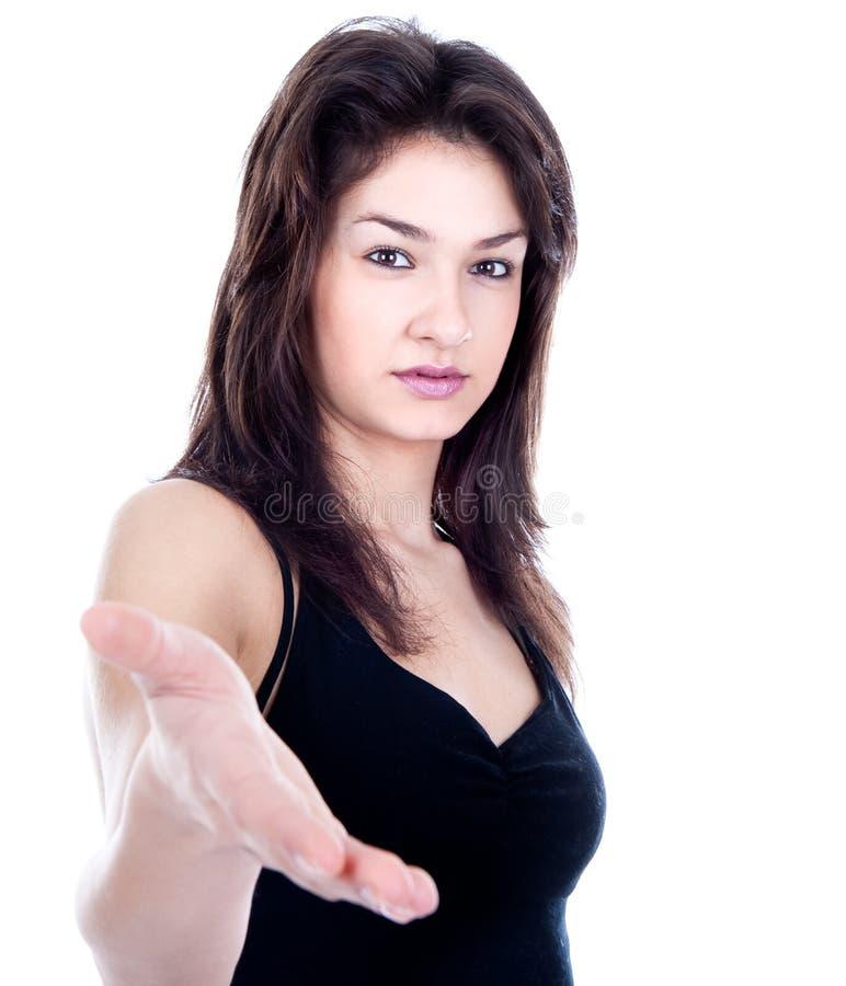 Een bedrijfsvrouw met een open hand stock foto
