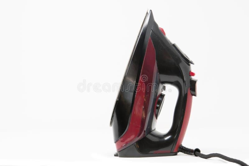 Een binnenlands rood en zwart elektrisch ijzer royalty-vrije stock afbeelding