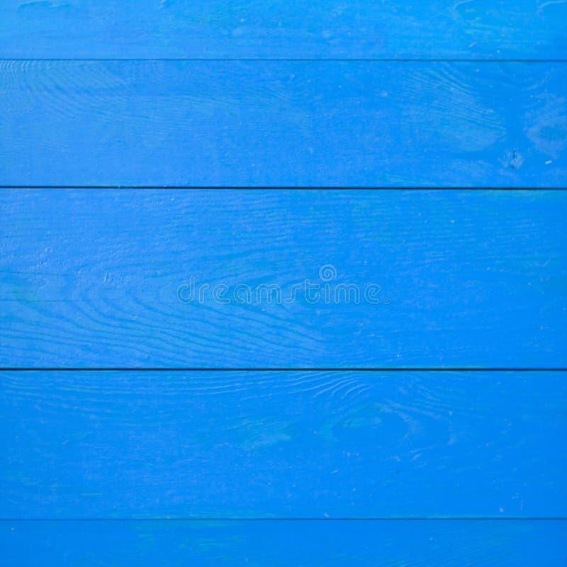 Een blauwe houten muur met horizontale planken stock foto