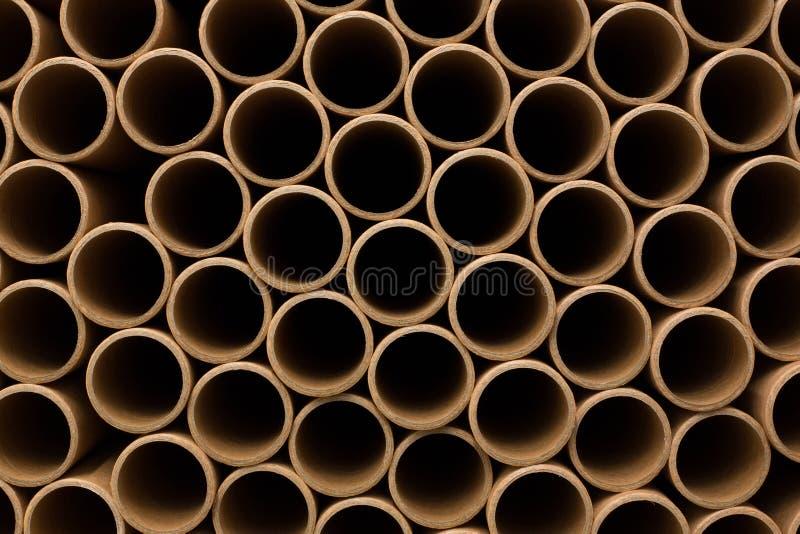 Een bos van bruine industriële document kern Heel wat document kernen of document buizen De Broodjes van het Pakpapier stock foto's