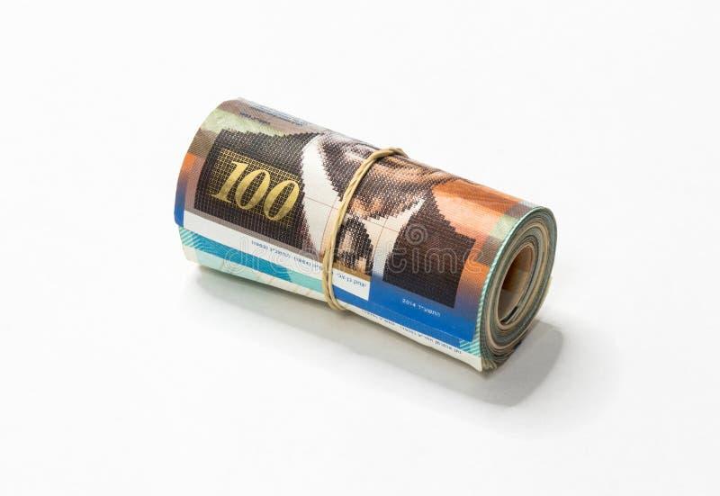 Een bos van het Israëlische Nieuwe geld van Sjekelsnos neemt van omhoog gerold en samengehouden met een eenvoudig elastiekje op e royalty-vrije stock afbeelding