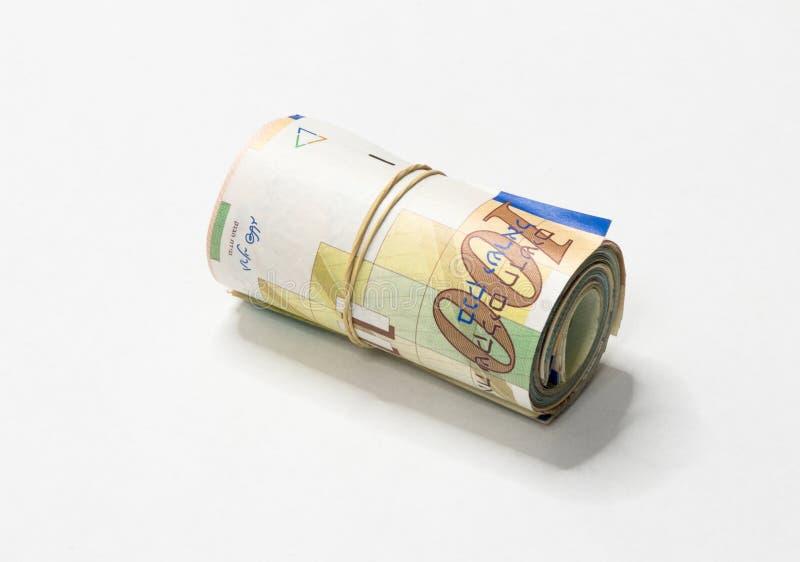 Een bos van het Israëlische Nieuwe geld van Sjekelsnos neemt van omhoog gerold en samengehouden met een eenvoudig elastiekje op e royalty-vrije stock foto's