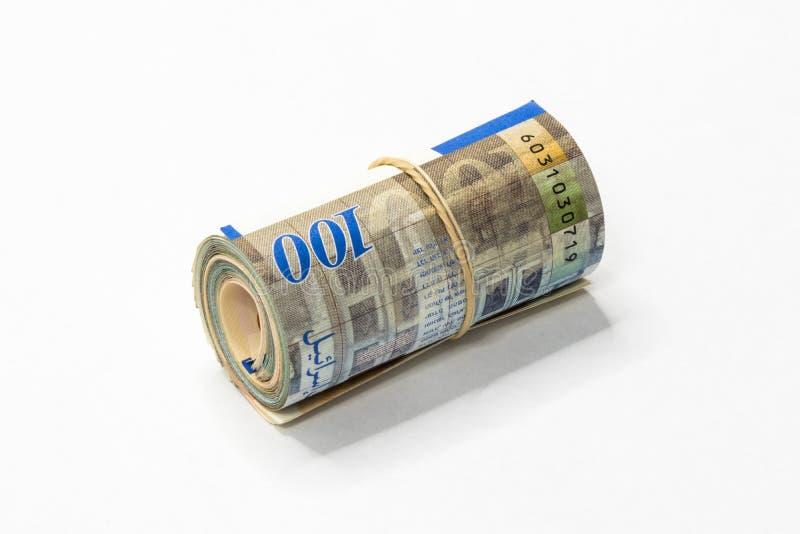 Een bos van het Israëlische Nieuwe geld van Sjekelsnos neemt van omhoog gerold en samengehouden met een eenvoudig elastiekje op e royalty-vrije stock afbeeldingen