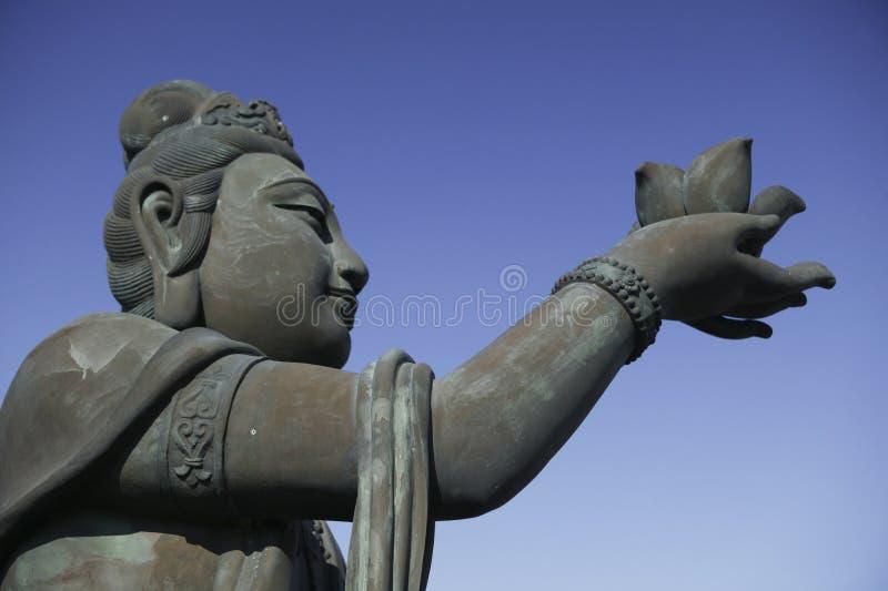 Een bronsstandbeeld van fee in Hongkong stock fotografie