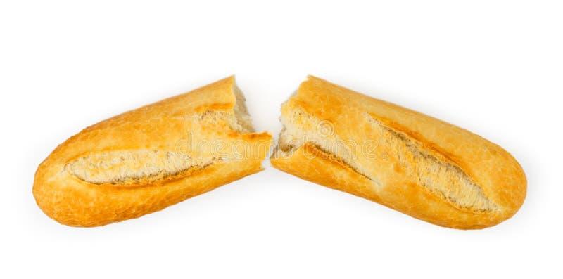 Een brood van wit brood dat in de helft op een wit wordt gebroken De mening vanaf de bovenkant royalty-vrije stock foto's