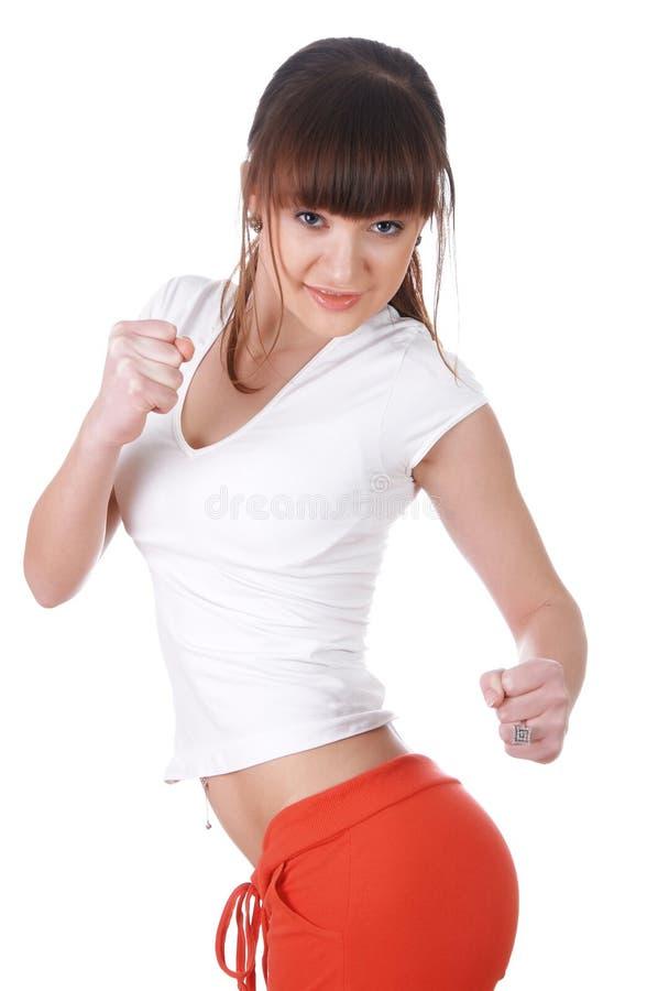 Een charmant jong meisje in een wit stock foto