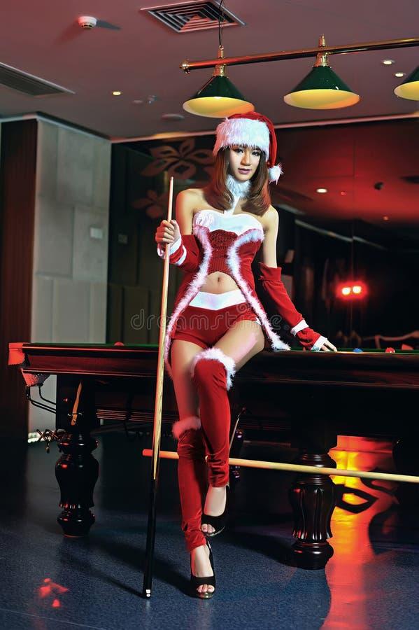 Een Chinees meisje kleedde zich in Kerstmiskostuums royalty-vrije stock afbeelding