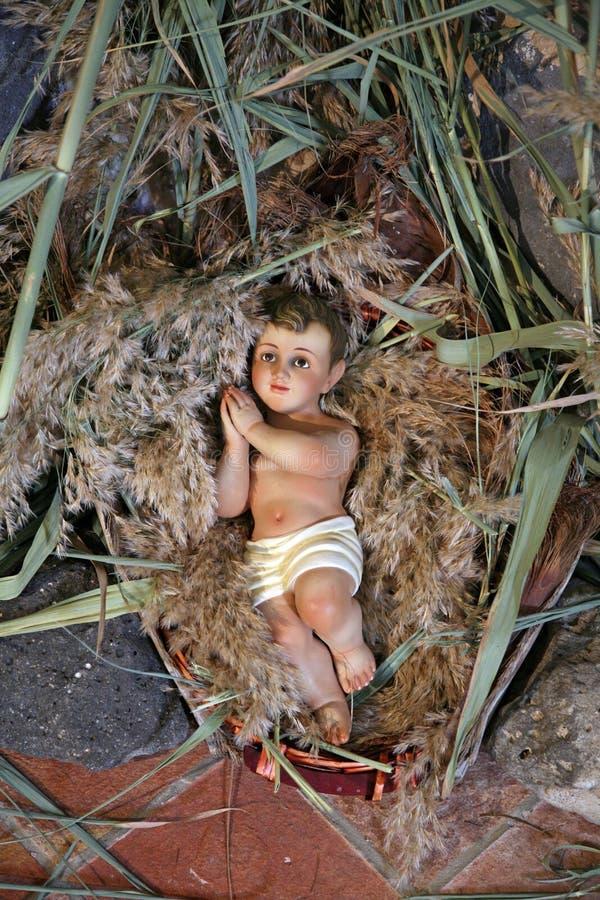 Een cijfer van babyJesus aangaande Kerstmis royalty-vrije stock foto's
