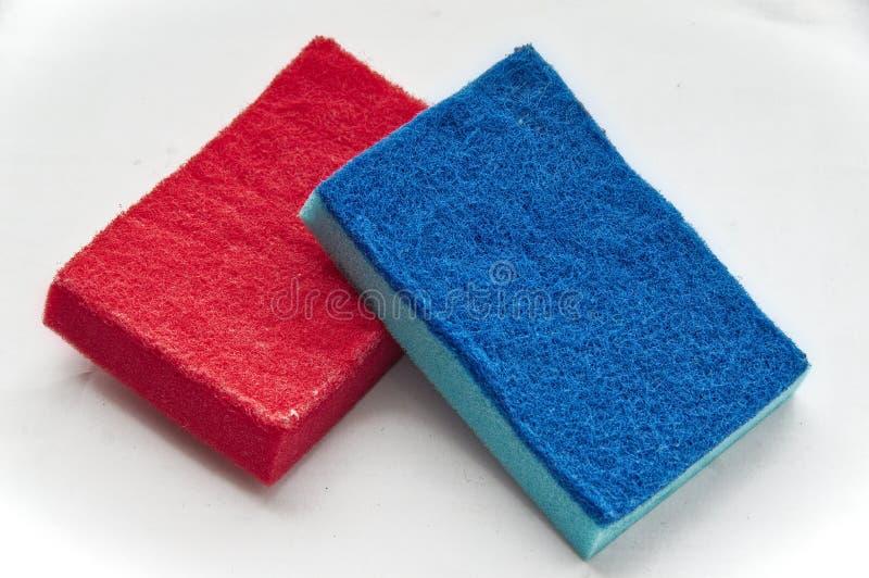 Een close-up van een rode spons stock afbeeldingen