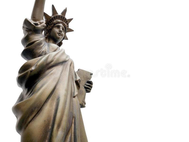 Een close-updeel van het Standbeeld van het bronsmetaal van Vrijheid op witte achtergrond wordt geïsoleerd die stock fotografie