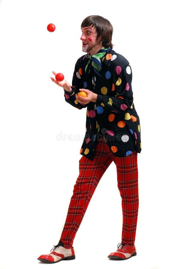 Een clown jongleert met ballen royalty-vrije stock foto