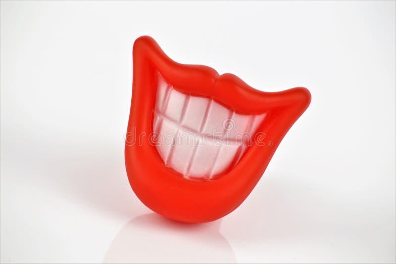 Een conceptenbeeld van een plastic mond, met exemplaarruimte stock foto's