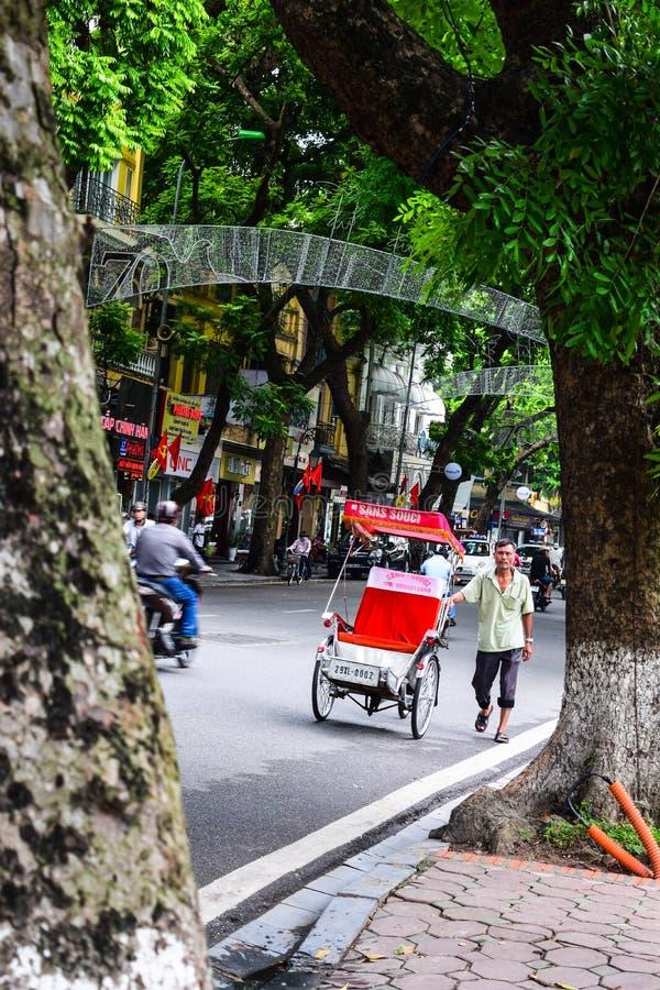 Een cyclobestuurder werkt op 2 Maart, 2012 in Ho Chi Minh City, Vietnam Cyclos is rond voor een meer dan eeuw, maar zij geweest stock afbeelding