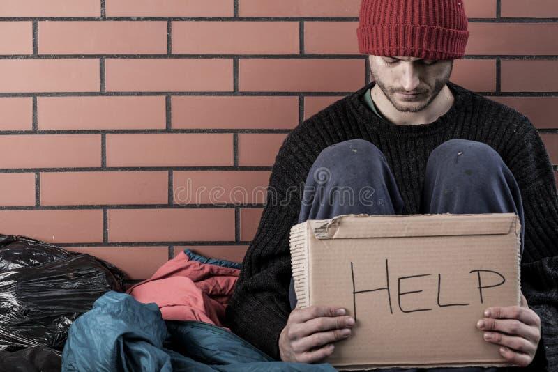 Een dakloos geld van de mensenbehoefte stock fotografie