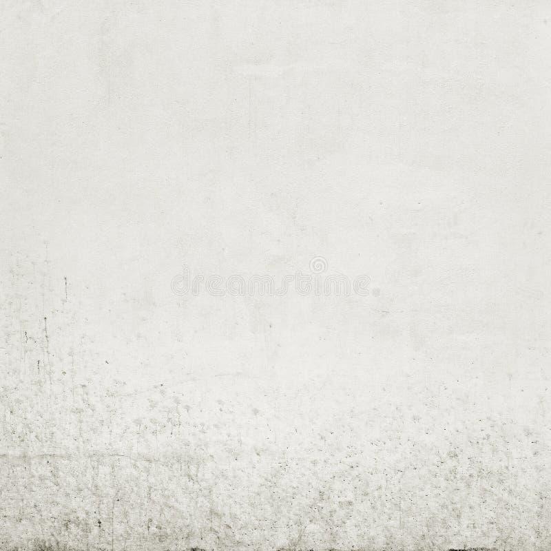 Een deel van achtergrond van de stuco de vuile witte muur stock foto's