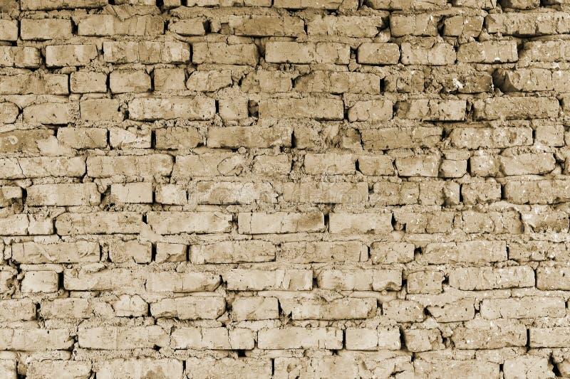 Een deel van de muur van baksteenstukken van een oud gebouw voor vernieling toning royalty-vrije stock afbeeldingen