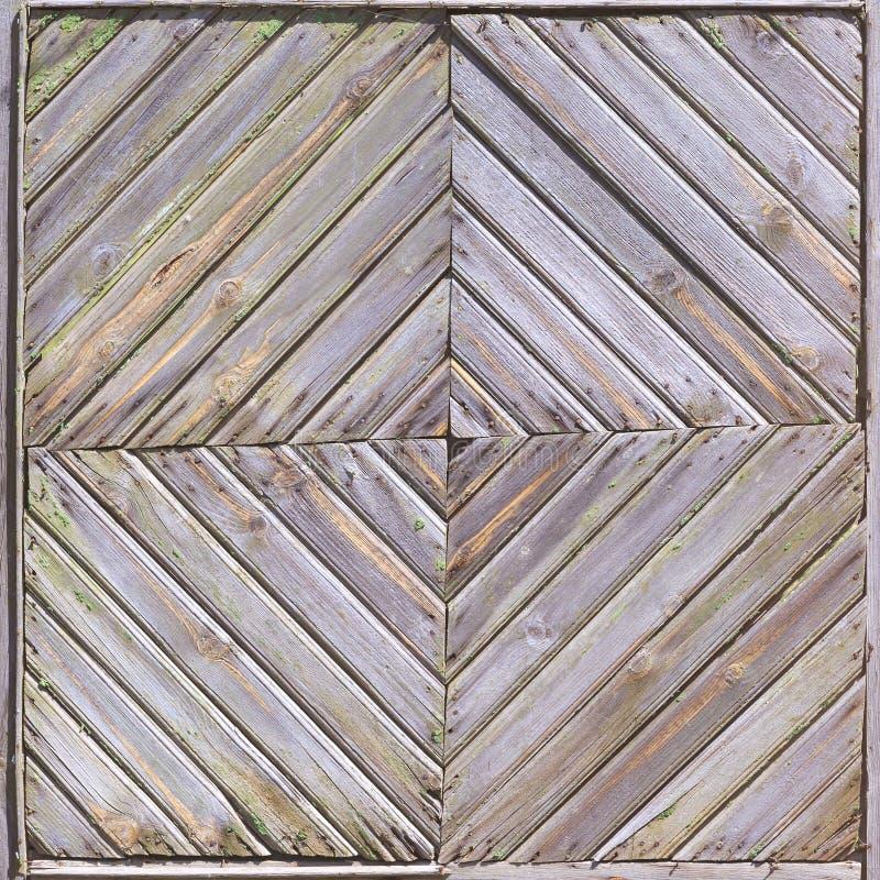Een deel van de oude houten die omheining in de vorm van een vierkant van planken wordt gemaakt royalty-vrije stock foto