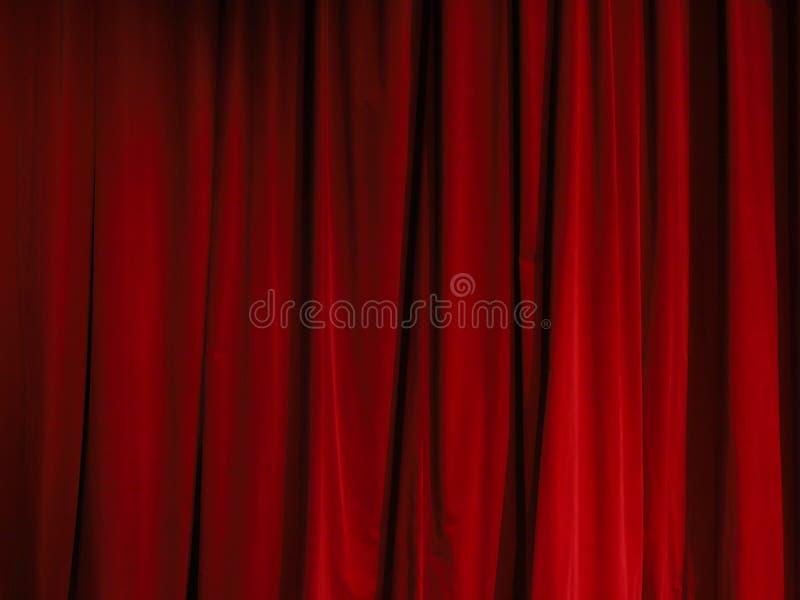Een deel van een rood gordijn stock foto's