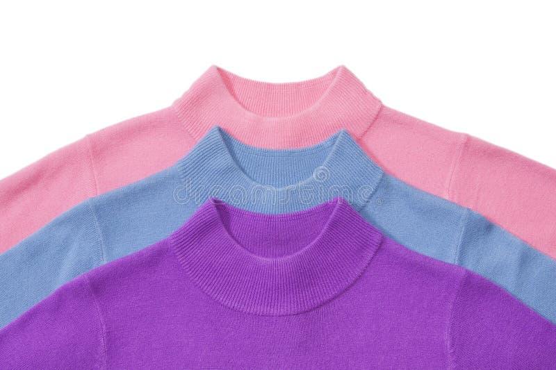 Een deel van stapel van drie sweaters stock foto's