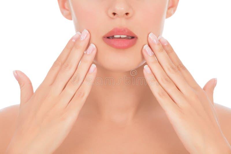 Een deel van vrouwengezicht met handen stock fotografie