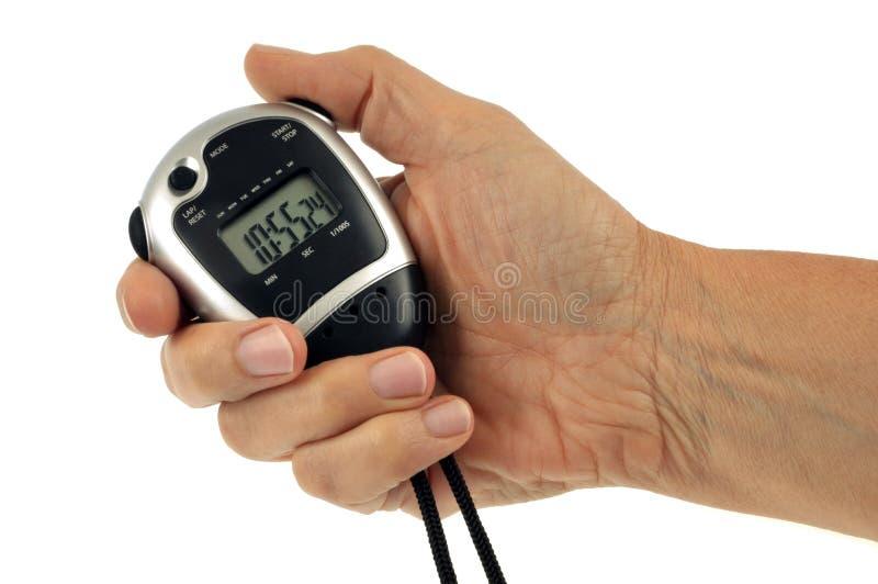 Een digitale chronometer ter beschikking stock foto's