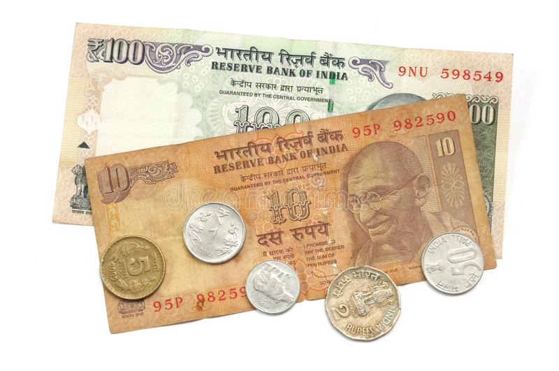 Een dollar van India tien, dollar honderd en sommige muntstukken royalty-vrije stock foto