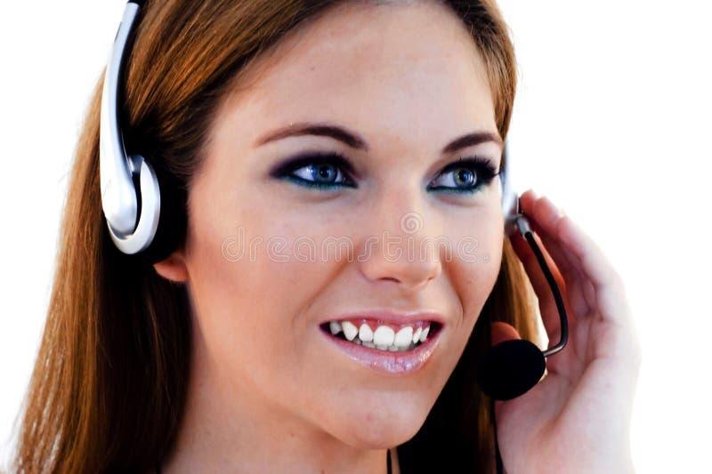 Een een vriendschappelijke Secretaresse/Exploitant van de Telefoon royalty-vrije stock fotografie
