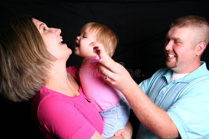 Een en Familie die lacht speelt royalty-vrije stock fotografie