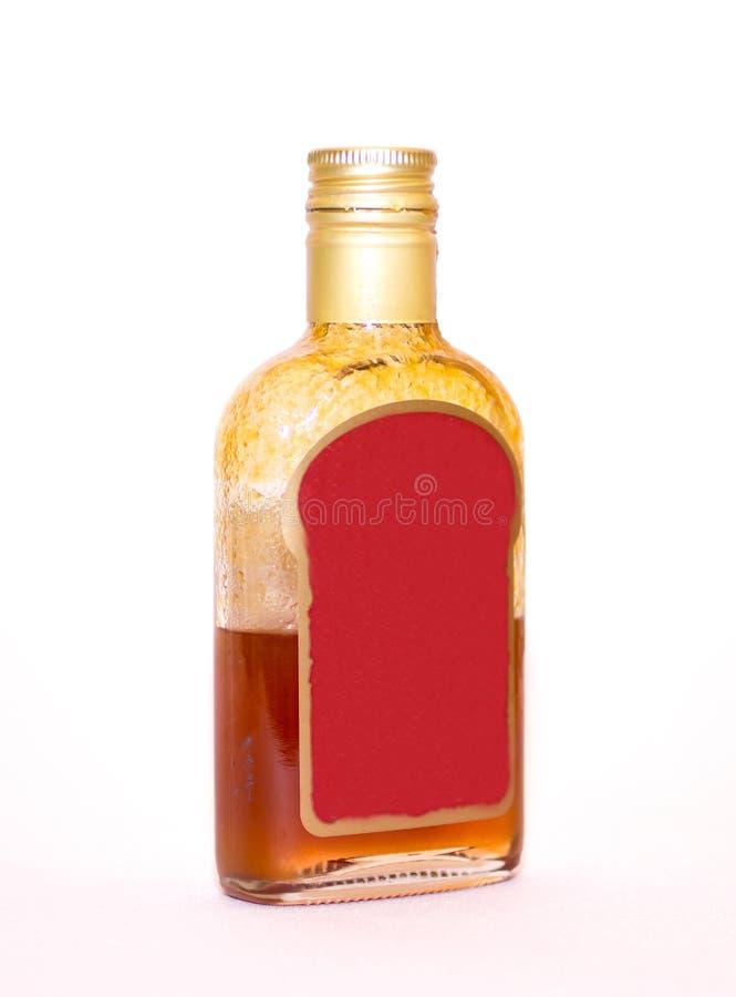 Een fles oranje duindoorntint is zeer nuttig voor het lichaam en het hoogtepunt van vitaminen royalty-vrije stock afbeeldingen