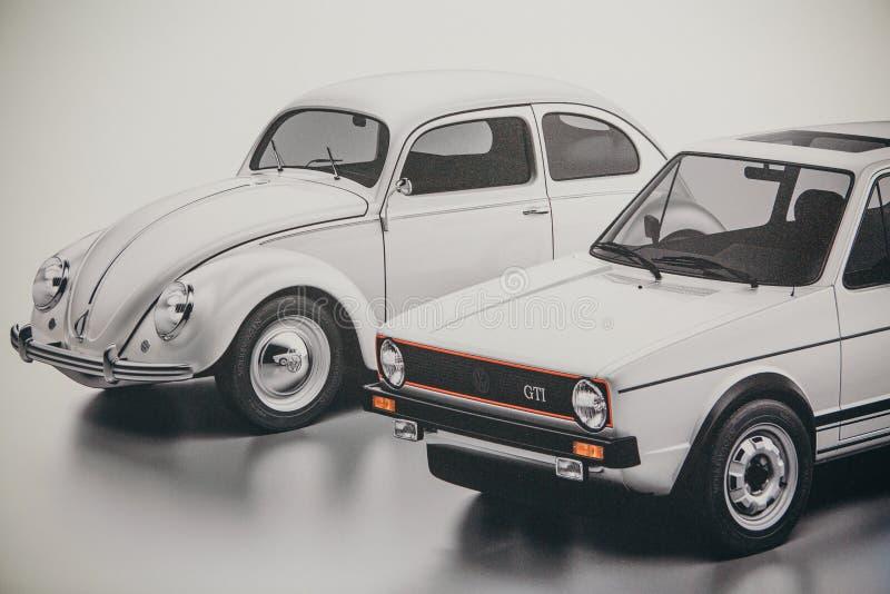 Een foto van een beeld van ouderwetse auto's Volkswagen Beetle en Jetta stock afbeelding