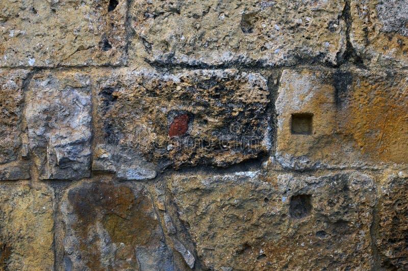 Een fragment van de oppervlakte van de muur wordt geconstrueerd van steenbl stock afbeelding