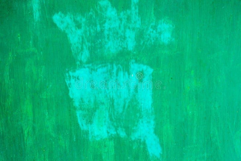 Een fragment van een groen geschilderd close-up van de metaalmuur de textuur en de achtergrond van de metaalmuur stock fotografie