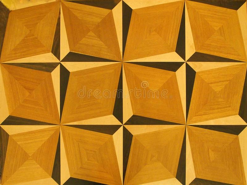 Een fragment van mozaïekbevloering, houten geweven patroon als achtergrond in lichtbruine kleuren royalty-vrije stock fotografie