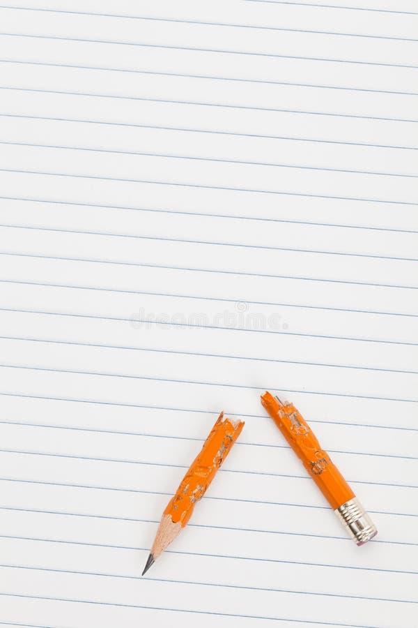 Een gebroken potlood stock afbeeldingen