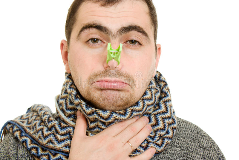 Een geduldige mens met een muffe neus stock foto's