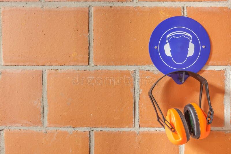 Een gehoorbeschermer stock afbeeldingen