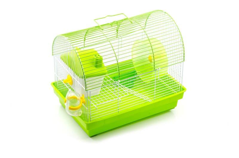 Een gele doos in een kleine gele hamsterkooi royalty-vrije stock afbeeldingen