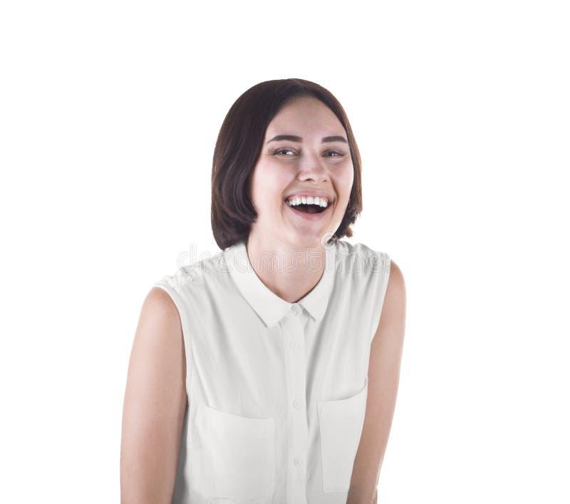 Een gelukkig glimlachende student Een aantrekkelijk die meisje op een witte achtergrond wordt geïsoleerd Een zeker donkerbruin wi royalty-vrije stock fotografie