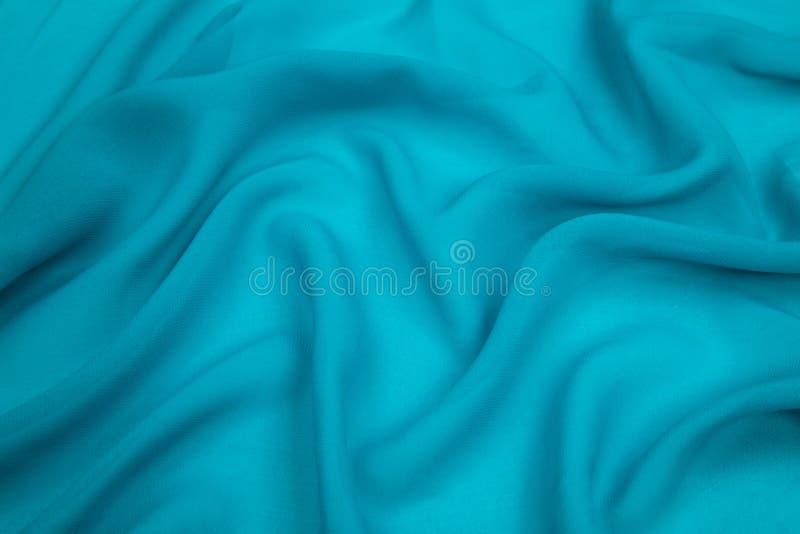 Een gevoelig gevoerd de stoffen turkoois blauw van de fauxzijde royalty-vrije stock foto's